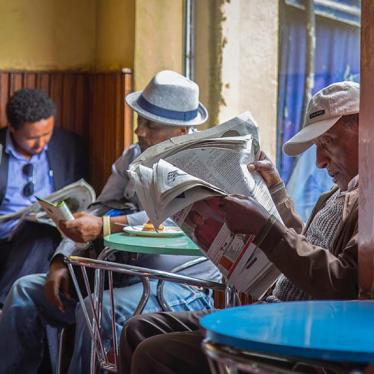 Ethiopian men read newspapers at a cafe during a declared state of emergency in Addis Ababa, Ethiopia.