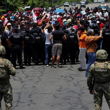 Mexican authorities stop a migrant caravan that had earlier crossed the Mexico - Guatemala border, near Metapa, Chiapas state, Mexico, Wednesday, June 5, 2019.