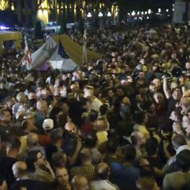 In this image from video, some thousands of protesters gather outside the parliament building in the Georgian capital of Tbilisi.