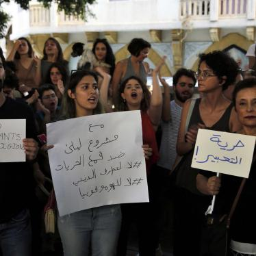 "A group of Lebanese activists chant slogans as they hold Arabic placards that read: ""Freedom of expression,"" right, and ""With Mashrou' Leila against the suppression of freedoms."