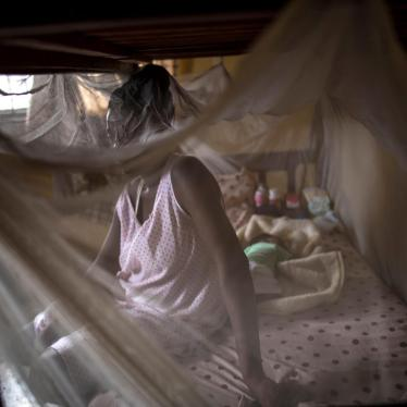 A woman from Cameroon sits with her baby in a private shelter in Lagos, Nigeria.