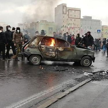 Iranian protesters gather around a burning car during a demonstration against an increase in gasoline prices in the capital Tehran, on November 16, 2019.