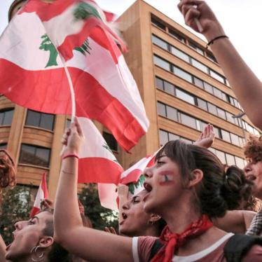 Women shout slogans and wave the Lebanese flag during a demonstration in down town Beirut.