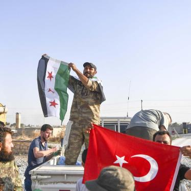 Fighters of the Turkish-backed Free Syrian Army (also called the Syrian National Army) enter the town of Tal Abyad.