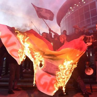 Demonstrators in Tbilisi burn an LGBT flag before the screening of the film And Then We Danced.