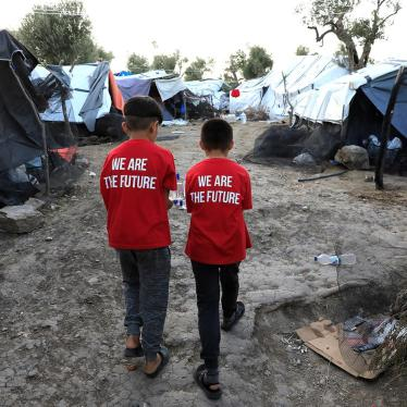 Two boys walk in a makeshift camp next to the Moria camp for refugees and migrants on the island of Lesbos, Greece, September 17, 2018.