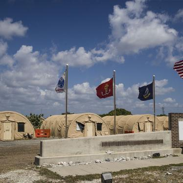 In this photo reviewed by US military officials, flags fly in front of the tents of Camp Justice, April 18, 2019, in Guantanamo Bay Naval Base, Cuba.