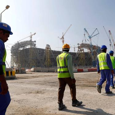 Workers walk towards the construction site of the Lusail stadium which will be build for the upcoming 2022 Fifa soccer World Cup during a stadium tour in Doha, Qatar, December 20, 2019.