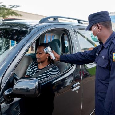 A Rwandan police officer checks the temperature of a motorist as he enforces a lockdown to stem the Covid-19 outbreak in Kigali, Rwanda, on April 15, 2020.