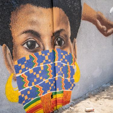 "A member of the Senegalese graffiti collective ""RBS CREW"" paints informational murals advising how to stop the spread of the new coronavirus, on the wall of a high school in the Parcelles Assainies neighborhood of Dakar, Senegal, March 25, 2020."