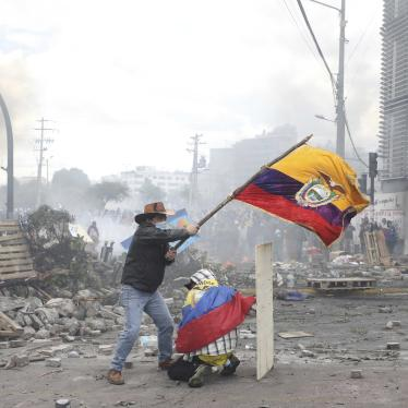 An anti-government demonstrator on Oct. 12, 2019 in Quito, Ecuador, waves the national flag during sometimes violent protests which began when President Lenin Moreno's decision to cut subsidies led to a sharp increase in fuel prices.