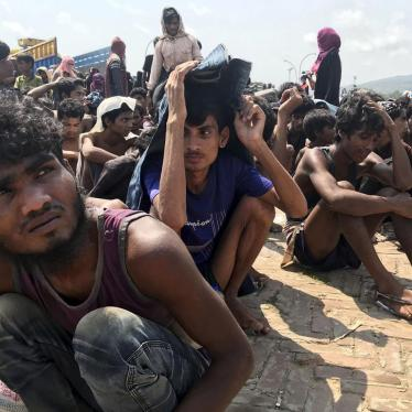 Rohingya refugees gather after being rescued in Teknaf near Cox's Bazar, Bangladesh, April 16, 2020.