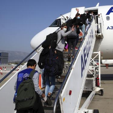 Migrant children board a plane for Luxembourg