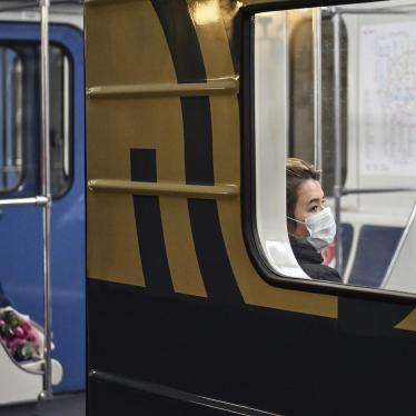 A woman wearing face mask sits in the train at the subway during the mandatory self-isolation amid coronavirus disease outbreak, in Moscow, Russia, April 2020.