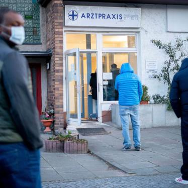 Patients line up in front of a medical practice in Berlin, Germany, to give blood samples for Covid-19 testing and possible detection of coronavirus antibodies, March 30, 2020.