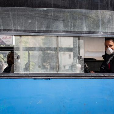 A man wearing a face mask rides in an almost empty bus in Cairo, Egypt, March 30, 2020.