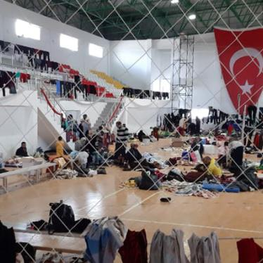 175 Syrian asylum seekers were held in a sports hall in the Turkish controlled part of northern Cyprus for two days before being transferred to apartment buildings where they continue to be detained. Photo taken in March 2020.