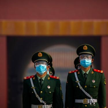 Chinese paramilitary police wear face masks in Beijing, May 1, 2020.