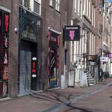 The narrow streets and alleys of Amsterdam's famed Red Light District, normally packed with tourists, seen largely deserted, March 16, 2020.